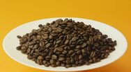 Coffee beans on a white plate Stock Footage