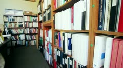 Man looking through business library Stock Footage