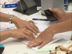 Woman gets fingerprinted - stock footage