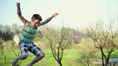 Happy young boy jumping on trampoline, slow motion HD Stock Footage