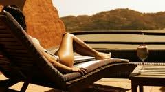 Bikini model sunbed with cocktail Stock Footage