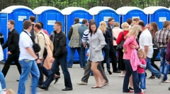 Crowd of people near public lavatory - stock footage