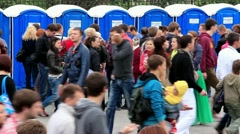Crowd of people near outdoor public toilets Stock Footage
