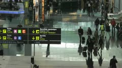 Time Lapse anonymous crowds moving throught an airport lounge Stock Footage