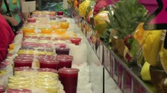 Fresh fruit drinks in the market Stock Footage