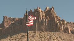 P01920 American Flag in Front of Capital Reef Stock Footage
