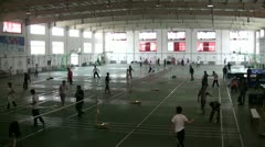 Playing badminton in a sports hall in China Stock Footage