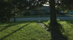Stock Footage - Time Lapse - Front yard in neighborhood - Cars, people pass Stock Footage