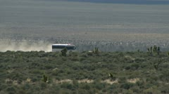 The White Bus Traveling on Groom Lake Rd 4 Stock Footage