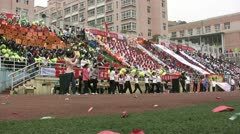 Chinese crowd cheers for long distance runners at unviersity festival Stock Footage