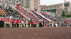 Crowd cheers on 100 metre runners at a Chinese student festival Stock Footage