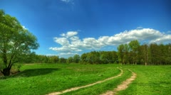 spring landscape with a rural road. HDR timelapse. - stock footage