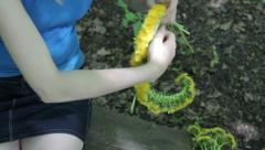 Woman weaves a wreath of dandelions 2 Stock Footage