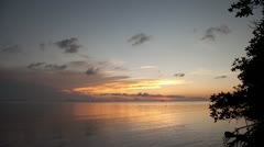 Colorful sunset over the sea on a tropical beach @ Koh Phangan, Thailand - stock footage