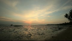 Sunset at the beach with reflections on the water at low tide @ Thailand Stock Footage