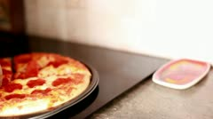 Woman Slicing Pizza in Kitchen Stock Footage