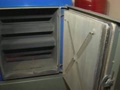 Man open boiler door Stock Footage