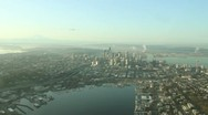 Stock Video Footage of Aerial Approach to Seattle and Space Needle on Calm, Smoggy Day