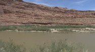 P01931 Colorado River and Bluffs from Moving Vehicle Stock Footage