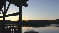 Rustic Building Sunrise At A Canadian Lake Time Lapse - stock footage