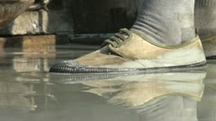Shoe of a Chinese worker in cement Stock Footage