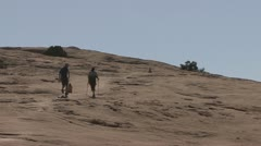 P01948 People Hiking Past Cairn in Arches National Park Stock Footage