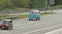 Blue VW Baywindow Bus on Freeway Driving Stock Footage