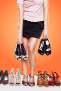 Woman with a passion for shoes Stock Photos