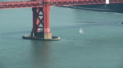 Sailboat under golden gate zoom out Stock Footage
