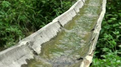 Close up of water going through bamboo to irrigate crops in China, Asia Stock Footage