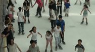 Stock Video Footage of Kids are ice skating at a rink in a Chinese shopping mall