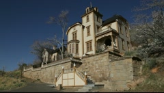 Generic mansion on the hill from western town, 898  Stock Footage
