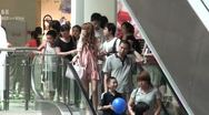 Stock Video Footage of Shoppers using escalators in a mall in Guangzhou, China