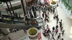 People on escalators in a shopping mall in Guangzhou Stock Footage