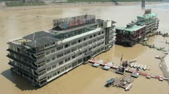 Floating restaurant / hotel in the Yangtze river, seen from above Stock Footage
