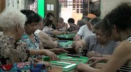 Elderly are playing one of China's favorite games: Mahjong Stock Footage