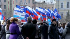 Flags of United Russia political party during the May Day demonstration Stock Footage