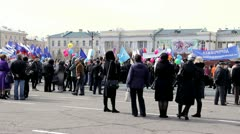 People in square during the May Day demonstration Stock Footage