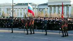 Military flag-bearers walks during parade Stock Footage
