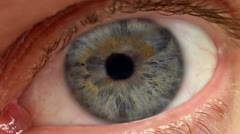 Zoom into pupil from extreme close up of human eye (eyeball) Stock Footage