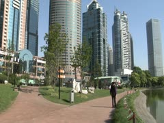 Pan around Lujiazui Green to reveal skyscrapers Stock Footage