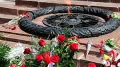 Flowers Lay Near Eternal Fire Stock Footage