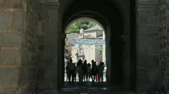 Toledo people walking through gate Stock Footage