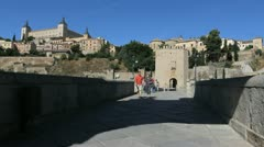Toledo Puente de Alcanrara with couple.walking - stock footage