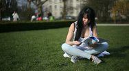 Young pretty woman study in park Stock Footage