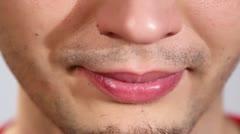Man smiles and smirks closeup Stock Footage