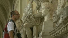 Tourist viewing statues at the Vatican Stock Footage