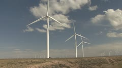 P01990 Moving Vehicle Shot of Wind Turbines in the Great Plains Stock Footage