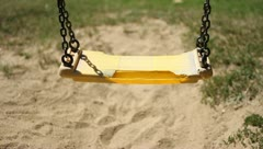 Swings, children's playground. - stock footage