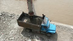 Unloading sand from a boat into a truck using a conveyor belt in China Stock Footage